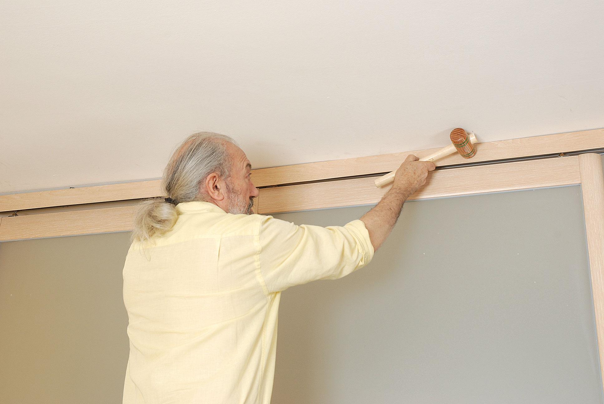 Portes coulissantes archives bricolage avec robert for Porte coulissante fixation plafond